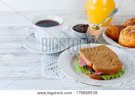 Healthy Breakfast With Egg , Sandviches, Toast, Jam And Juce