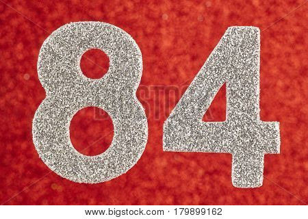 Number eighty-four silver color over a red background. Anniversary. Horizontal