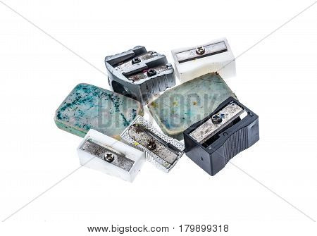 Different Old Used  Pencil Sharpeners And White Rubber Pen Eraser.