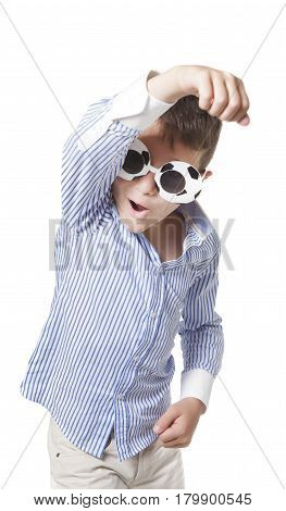 Young cool caucasian boy with sunglasses esulting