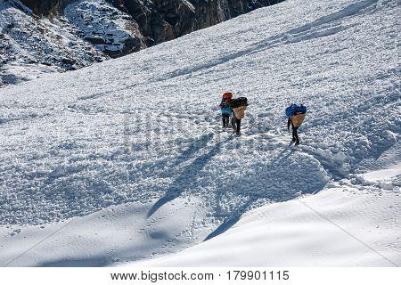 Porters crossing Cho La pass in Everest region Nepal