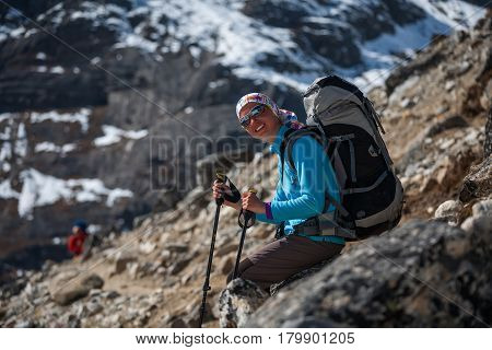 Trekker rests on stone in Khumbu valley on a way to Everest Base camp