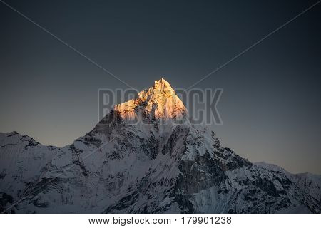 Amadablam peak at sunset in Khumbu valley in Nepal Himalayas