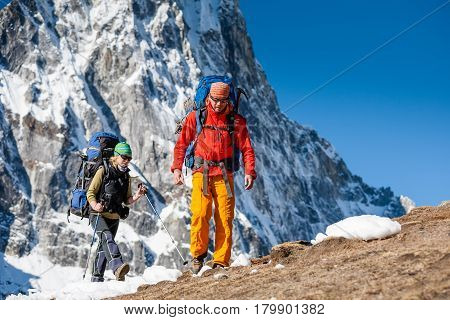 Trekkers are in Khumbu valley on a way to Everest Base camp