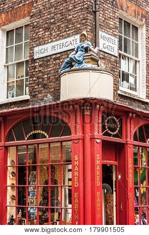 York North Yorkshire United Kingdom - June 23 2006: Street sign for High Petergate and Minster Gates. Goddess of Wisdom Figure at the corner of the High Petergate and Minster Gates Streets.