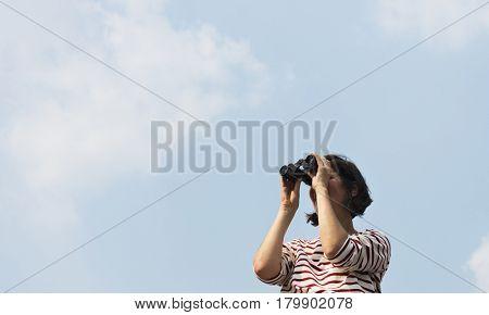 Woman using binocular explore searching