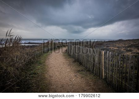 Path on the coast of la Chaume in bad and dark weather (Les Sables d'Olonne, France)