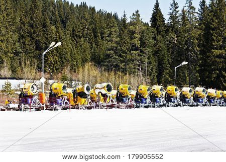 Bansko, Bulgaria -March 24 2017: Close-up image of yellow snow cannons in a high mountain.