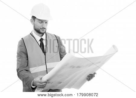 Making sure all is good. Monochrome studio portrait of a mature businessman engineer in a safety vest and a hardhat working on a building project holding blueprints copyspace on white background