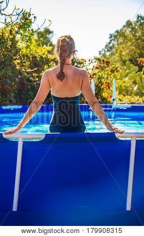 Active Woman Standing In Blue Beachwear In Swimming Pool