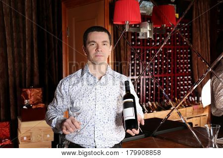 Man holding bottle of red wine