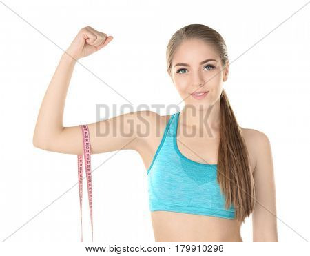 Diet concept. Young beautiful woman with measuring tape on white background