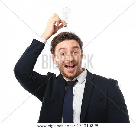 Handsome young man posing with lamp on white background