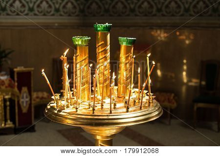 Burning wax candles in a candlestick in the Orthodox  church.