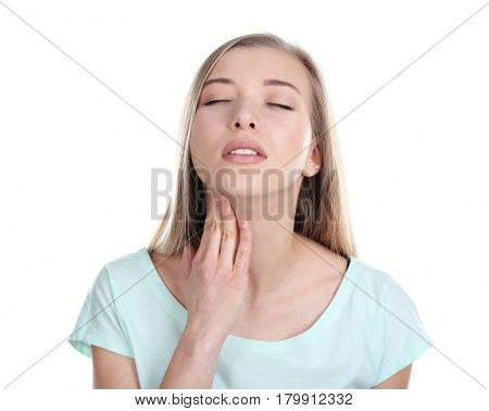 Sick young woman having pain in throat on white background