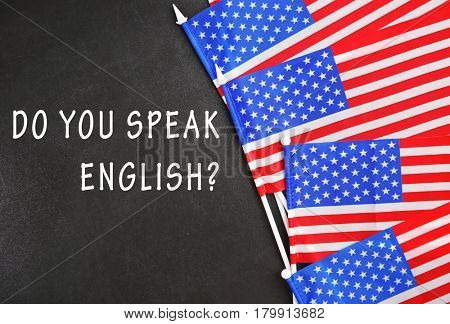 USA flags and question DO YOU SPEAK ENGLISH on blackboard background