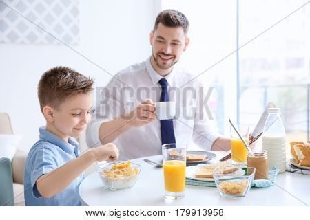 Dad and son having lunch at home