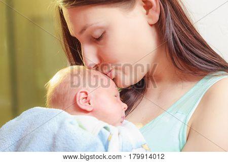 Beauty of parenting motherhood love concept. Mother holding her little newborn baby