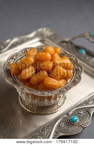 Delicious bowl of Awwama - a traditional middle eastern dessert served in an ornamental bowl.