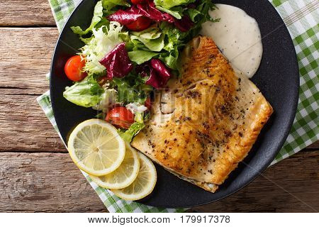 Fried Fillet Of Fish Arctic Char With Fresh Salad And Sauce Close-up. Horizontal Top View