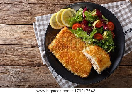 Fried Arctic Char Fish Fillet In Breadcrumbs And Fresh Vegetable Salad Close-up. Horizontal Top View