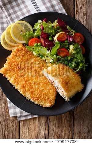 Fish Fillet Of Arctic Char In Breadcrumbs And Fresh Salad Close-up. Vertical Top View