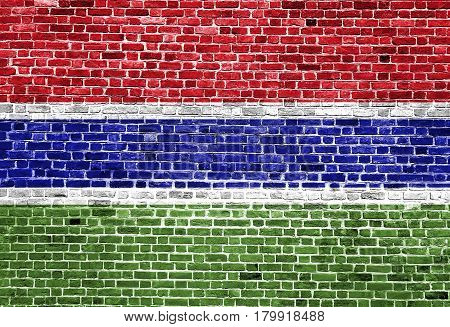 Flag of Gambia painted on brick wall, background texture