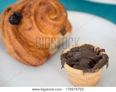 Chocolate cream nutella and croissant breakfast concept