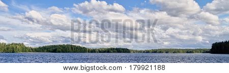 Panorama Landscape With Dramatic Cumulus Clouds In The Bright Summer Day Scene In Finland