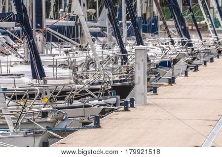 Bows Of Sailing Yachts Parked In A Harbor