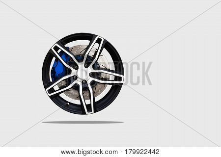 Close up of a modern sport wheel with brake disk and caliper pad. isolated background and clipping path.