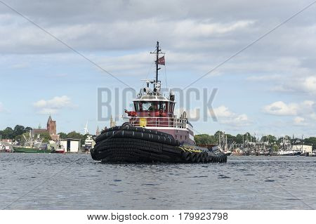 New Bedford Massachusetts USA - August 21 2014: Tug crossing Acushnet River inner harbor in New Bedford Massachusetts