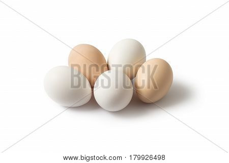 Three white and two brown eggs on a white background