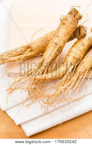 Korean Fresh Ginseng over wood background