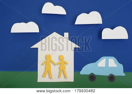 Paper cutout couple with house and car