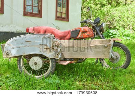 old vintage russian motorcycle with three wheels