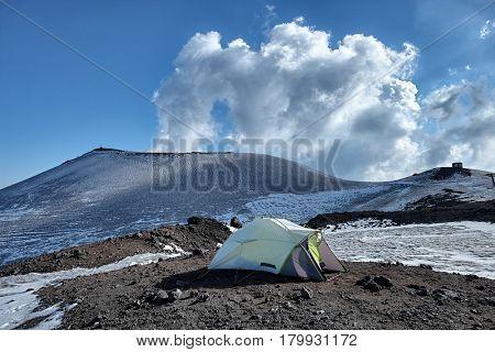 wild camp on volcanic rock in winter Etna Park, Sicily