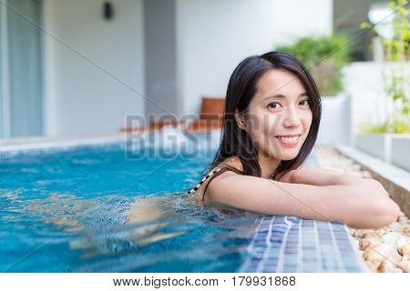 Young Woman enjoy jacuzzi spa with bikini