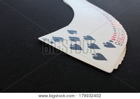 The combination of playing cards poker casino. Isolated on black poker table background