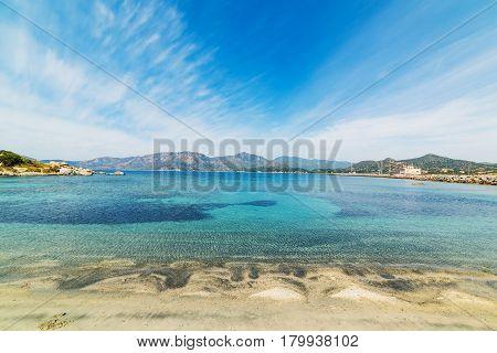 Clouds over Fortezza Vecchia beach in Sardinia