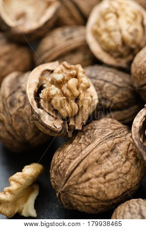 Fresh organic walnuts close up vertical full frame