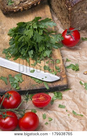 chopped parsley on a chopping board, copy space