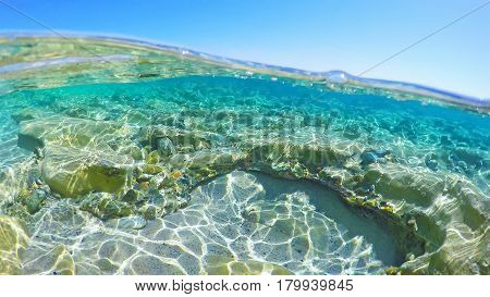 Rocks and sand underwater in Sardinia, Italy