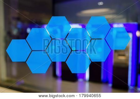 hexagon shaped pattern design for abstract technology background or copy blank space with abstract blurred background of ATM Machine for withdraw or deposit cash money color tone effect.