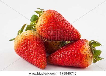 Strawberry ( Fragaria ananassa ) on white background