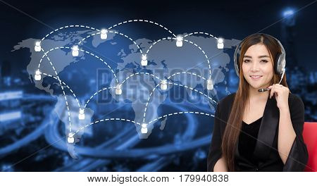 portrait of asian woman support phone operator or call center in headset sitting on red chair with global media connection on blurred night city background customer support and service concept.