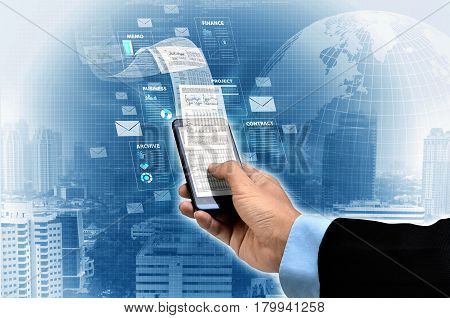 Businessman raeding financial and business report on his smart phone.