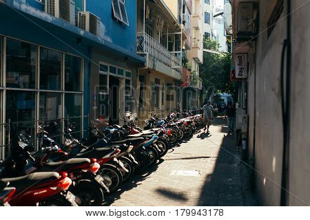 Male, Maldives - December 17, 2016: Motorcycles is parked at parking lot in the city of Male the capital of the Maldives
