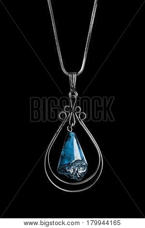 Vintage topaz pendant on silver chain isolated over black