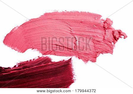 Macro photo of pink and purple smeared Lipstick isolated on white Background